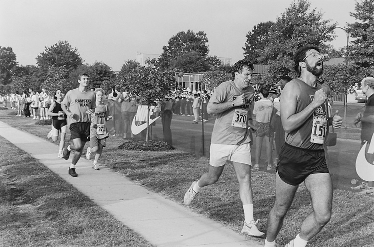 Rep. Jim Ramstad, R-Minn., finishes ahead of his L.A. Kate Flaherty and intern Kurt Johnson on Sep. 15, 1993. (Photo by Chris Martin/CQ Roll Call via Getty Images)