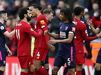 7th March 2020; Anfield, Liverpool, Merseyside, England; English Premier League Football, Liverpool versus AFC Bournemouth; Mohammed Salah of Liverpool fist bumps Nathan Ake of Bournemouth  as the match ends with a 2-1 Liverpool win