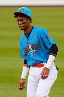 Wisconsin Timber Rattlers third baseman Yeison Coca (1) warms up in the outfield prior to a Midwest League game against the Lake County Captains on May 10, 2019 at Fox Cities Stadium in Appleton, Wisconsin. Wisconsin defeated Lake County 5-4. (Brad Krause/Four Seam Images)