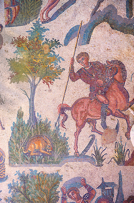 Hunter on a horse about to spear a hare from the Room of The Small Hunt, room no 25 - Roman mosaics at the Villa Romana del Casale which containis the richest, largest and most complex collection of Roman mosaics in the world. Constructed  in the first quarter of the 4th century AD. Sicily, Italy. A UNESCO World Heritage Site.