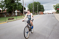 Brayden Hamilton of Springdale rides, Saturday, May 16, 2020 along Johnson Ave. in Springdale. Springdale will partner with the Downtown Springdale Association for sidewalk improvement on Johnson, Commercial and Spring streets. Check out nwaonline.com/200519Daily/ for today's photo gallery.<br />