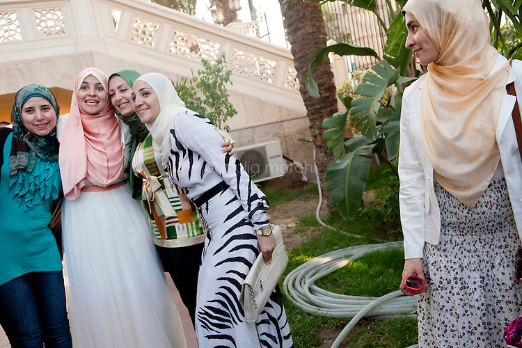 Egypt / Cairo / 14.7.2012 / Manar, a Sister, takes pictures with friends following her wedding in El Rahman El Rahim Mosque, in Abbasseya, Cairo, Egypt. July 14th, 2012.<br /> <br /> © Giulia Marchi