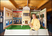 BNPS.co.uk (01202) 558833<br /> Picture: Peter Willows<br /> <br /> Every little girls Xmas wish...A meticulously crafted dolls house that has taken Len Martin from Dorset 26 years to complete in his garden shed.<br /> <br /> Len is now selling his masterpiece in time for Xmas..but any bidders for 'Langdon Hall' will need deep pockets to come up with the &pound;10,000 asking price.<br /> <br /> Leonard Martin, 68, was inspired to make the ornate house after he doodled a picture of his 'perfect home' on a scrap of paper while he was bored at work in 1987.<br /> <br /> He has worked on the miniature property up to five hours a day since then to build the extravagant home and make his dreams a reality.<br /> <br /> The 6ft 2ins long and 3ft 6ins tall building has two bedrooms, two bathrooms, a kitchen, sitting room, dining room, and hallway all filled with tiny furniture.<br /> <br /> Leonard has spared no expense on the detailed Georgian manor and has spent more than 6,000 pounds building and filling the rooms.<br /> <br /> He has splashed out on detailed finishes and period furnishings including a Swarvoski crystal chandelier, hand stitched carpets, and real marble flooring.<br /> <br /> There are miniature beds, settees, cupboards, baths, toilets, and even tiny oil paintings that look like their huge counterparts - including the Mona Lisa.<br /> <br /> After working on the incredibly intricate Langdon House for more than a third of his life, Leonard has now decided to sell it and hopes to fetch around 9,000 pounds.<br /> <br /> Leonard, who used to own a miliary memorabilia shop and lives in Charlton Marshall near Blandford,Dorset, said: &quot;It all began when I was in my shop one