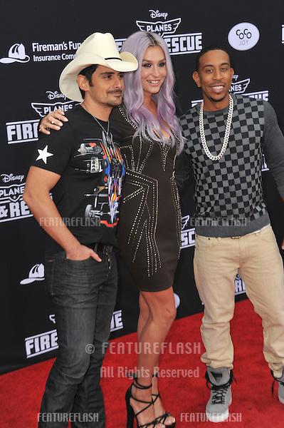 Brad Paisley, Kesha &amp; Chris &quot;Ludacris&quot; Bridges at the world premiere of Disney's &quot;Planes: Fire &amp; Rescue&quot; at the El Capitan Theatre, Hollywood.<br /> July 15, 2014  Los Angeles, CA<br /> Picture: Paul Smith / Featureflash