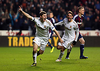 Saturday 19 January 2013<br /> Pictured L-R: Ben Davies of Swansea celebrating his opening goal with team mate Michu.<br /> Re: Barclay's Premier League, Swansea City FC v Stoke City at the Liberty Stadium, south Wales.