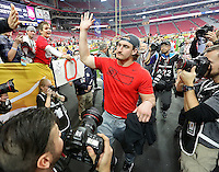 Ohio State Buckeyes defensive lineman Joey Bosa (97) waves goodbye and high fives fans as he leaves the field at University of Phoenix Stadium in Glendale, AZ on January 1, 2016. The Buckeyes beat Notre Dame 44-28.  (Chris Russell/Dispatch Photo)