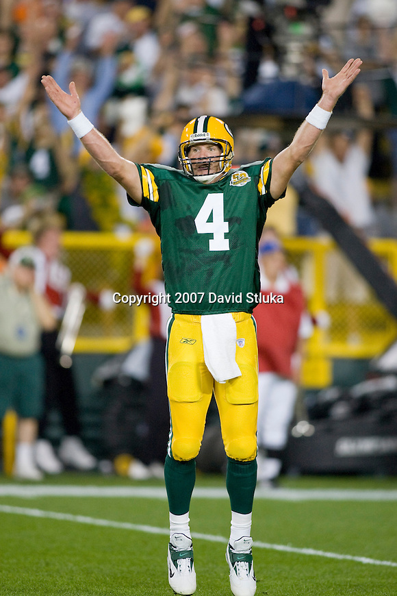 Quarterback Brett Favre #4 of the Green Bay Packers celebrates the Packers first touchdown during an NFL football game against the Chicago Bears at Lambeau Field on October 7, 2007 in Green Bay, Wisconsin. The Bears beat the Packers 27-20. (Photo by David Stluka)