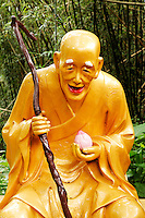 Statue of a Buddha along trail to Ten Thousand Buddhas, Sha Tin, New Territories, Hong Kong SAR, People's Repbulic of China, Asia