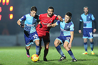 Scott Kashket of Wycombe Wanderers (left), Paul McCallum of Leyton Orient (2nd left) and Luke O'Nien of Wycombe Wanderers  (3rd left) battle for the ball during the Sky Bet League 2 match between Wycombe Wanderers and Leyton Orient at Adams Park, High Wycombe, England on 17 December 2016. Photo by David Horn / PRiME Media Images.