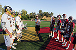 Mission Viejo, CA 05/11/11 - Davis Edwards (St Margaret #32), James Murayama (St Margaret #16), unidentified St Margaret players engage in the coin toss ceremony before the game.