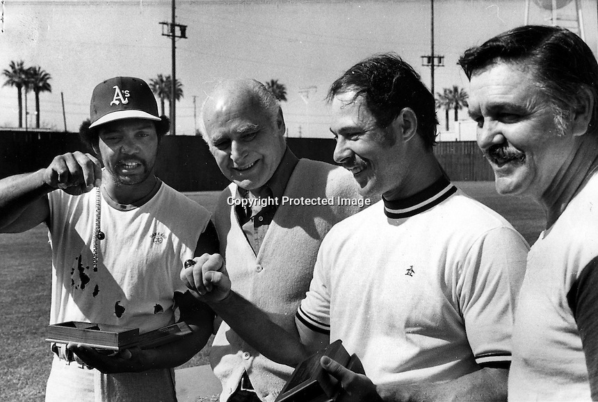 A's admiring their World Series rings, Reggie Jackson,.Charlie Finley, Gene Tenace, and Mgr. Dick Williams..(photo 1973 Ron Riesterer)