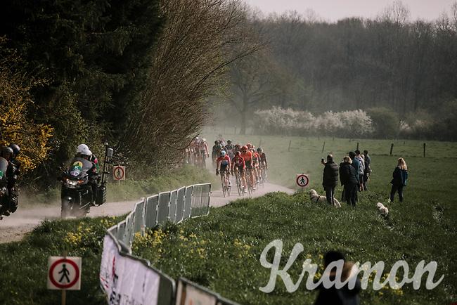 Peloton approaching on the gravel sector; the Plugstreets<br /> <br /> 8th Gent-Wevelgem In Flanders Fields 2019 <br /> Elite Womens Race (1.WWT)<br /> <br /> One day race from Ypres (Ieper) to Wevelgem (137km)<br /> ©JojoHarper for Kramon