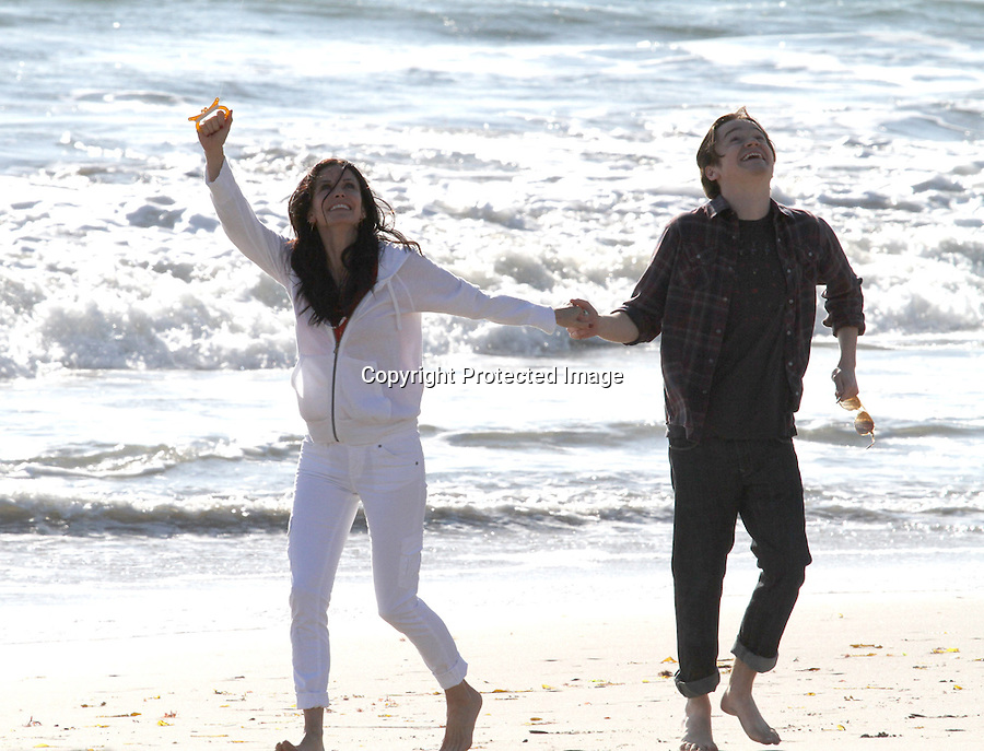 February 22st 2011  ..Courteney Cox & co star Byrd Dan hugging & flirting while playing on the beach & shoveling sand & building sand castles & flying a kite at in Malibu California ...AbilityFilms@yahoo.com.805-427-3519.www.AbilityFilms.com.