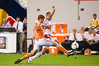 Joel Lindpere (20) of the New York Red Bulls and Andre Hainault (31) of the Houston Dynamo go for the ball. The New York Red Bulls defeated the Houston Dynamo 2-0 during a Major League Soccer (MLS) match at Red Bull Arena in Harrison, NJ, on August 10, 2012.