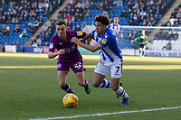 Courtney Senior of Colchester United tries to get past the attention of Stefan Scougall of Carlisle United during Colchester United vs Carlisle United, Sky Bet EFL League 2 Football at the JobServe Community Stadium on 23rd February 2019