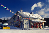 gas station, Vermont, VT, Gas station and garage with antique gas pumps in the village of Orange in the snow in winter.