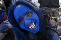 Pictured: A flour wars participant with a blue face in Galaxidi, Greece. Monday 11 March 2019<br /> Re: Clean Monday (Monday of Lent) celebration of flour wars (Alevromoutzouroma) in the town of Galaxidi, which coincides with the beginning of the Greek Orthodox Lent in Greece. The origins of the custom are unclear, however it appears in its current form since the mid-19th century.<br /> Locals and visitors of all ages gather to collect large quantities of flour which they throw to each other. Various types of coloring is added for effect while people paint their faces with charcoal.