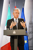 Mario Monti, Prime Minister of Italy, answers a question in a press conference