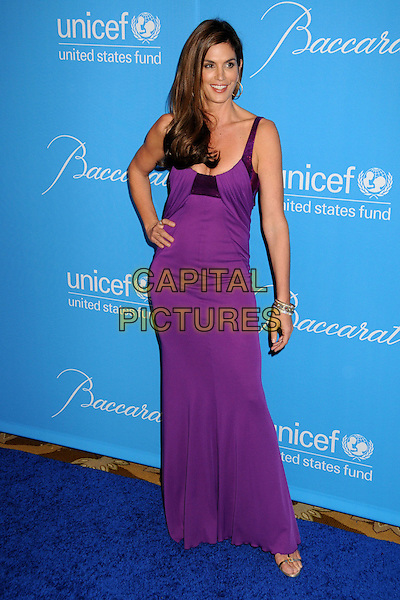 CINDY CRAWFORD.UNICEF Ball 2009 Honoring Jerry Weintraub held at the Beverly Wilshire Hotel, Beverly Hills, California, USA..December 10th, 2009.full length dress purple maxi sequins sequined hand on hip.CAP/ADM/BP.©Byron Purvis/AdMedia/Capital Pictures.
