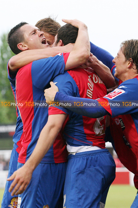 Graeme Montgomery of Dagenham celebrates scoring the winning goal with Mark Arber - Dagenham & Redbridge vs Hereford United 01/05/2010 - MANDATORY CREDIT: Dave Simpson/TGSPHOTO - Self billing applies where appropriate - 0845 094 6026 - contact@tgsphoto.co.uk -NO UNPAID USE