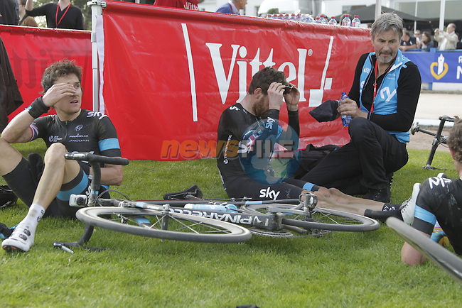 Team Sky's Geraint Thomas (WAL) and Bradley Wiggns (GBR) exhausted after the finish of the 112th edition of the Paris-Roubaix cycle race in 3rd place, Roubaix, France. 13th April 2014.<br /> Picture: Eoin Clarke www.newsfile.ie