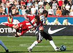 Almami da Silva Moreira of Partizan Belgrade, right, tackles Red Star player Pavle Ninkov, left,  during the Serbian League soccer match in Belgrade, Serbia, Saturday, October  24, 2010. (Srdjan Stevanovic/Starsportphoto.com)