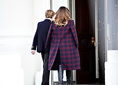 First lady Melania Trump and son Barron return inside after accepting the White House Christmas tree on the North Portico of the White House in Washington, DC on Monday, November 20, 2017.  The tree will stand in the Blue Room.<br /> Credit: Ron Sachs / CNP