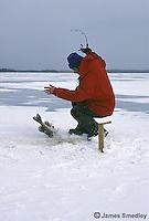 Man icefishing northern Pike