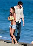 July 2nd 2012 Ashley Tisdale wearing a lime yellow bikini top and short jean shorts daisy dukes celebrating her 27th  birthday on the beach in Malibu California.  Ashley brought her dog & invited celebrity friends like Selena Gomez & boyfriend Scott Speer. AbilityFilms@yahoo.com805-427-3519www.AbilityFilms.com