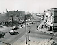"1956 February 01..Redevelopment.Downtown North (R-8)...Brambleton Avenue (After)..Photograph shows newly widened Brambleton Avenue and surroundind redeveloped area.  Note church spire in both ""before"" and ""after"" pictures...PHOTO CRAFTSMEN INC..NEG#.NRHA#.."