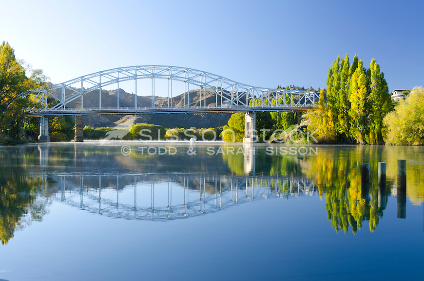 Reflections, Alexandra Bridge over the Clutha River in early Autumn, Central Otago, New Zealand - stock photo, canvas, fine art print