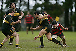 A. Ah Sui tries to avoid the tackle of R. Smith. Counties Manukau Premier 2 Championship game between Bombay and Papakura played at Bombay on May 13th, 2006. Papakura won 8 - 7.
