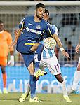 Getafe's Angel Lafita (f) and Malaga's Fernando Damian Tissone during La Liga match.September 18,2015. (ALTERPHOTOS/Acero)