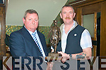 2710-2711.---------.Marching Orders.---------------.After 31 yrs,retiring army officer,Quarter master Alan Hanafin,Ballyseedy,Tralee(Lt)recieves a fabulous statue of Legend Michael Collins from Sargent Major Stan Hurley of Sarfield army barricks Limerick,in Gally's bar/restaurant,Tralee last Friday night.