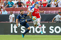 Landover, MD - July 23, 2019: Real Madrid Nacho (6) tries to kick the ball away from Arsenal Sead Kolasinac (31) during the match between Arsenal and Real Madrid at FedEx Field in Landover, MD.   (Photo by Elliott Brown/Media Images International)