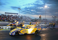 Jul. 19, 2013; Morrison, CO, USA: NHRA funny car driver Matt Hagan (near) races alongside teammate Ron Capps during qualifying for the Mile High Nationals at Bandimere Speedway. Mandatory Credit: Mark J. Rebilas-