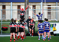 Action from the Wellington under-55kg boys rugby union match between St Patrick's College Town (blue and white) and Scots College (white red and black) at the St Patrick's College Artificial Turf, Wellington, New Zealand on Friday, 26 June 2015. Photo: Dave Lintott / lintottphoto.co.nz