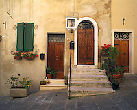 Tuscany, Italy      <br /> Three doors and steps on a slanted street in the ancient hilltown of Montepulciano