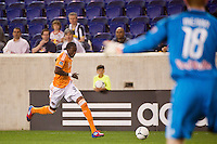 Macoumba Kandji (9) of the Houston Dynamo moves up the flank. The New York Red Bulls defeated the Houston Dynamo 1-0 during a Major League Soccer (MLS) match at Red Bull Arena in Harrison, NJ, on May 09, 2012.