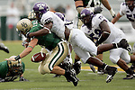TCU's Brian Bonner sacks Baylor's quarterback Shawn Bell on a third down play in the first quarter during their NCAA football game in Waco on Sunday, September 3, 2006. (photo by Khampha Bouaphanh)