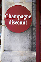 A round sign outside a wine shop saying champagne discount, Reims, Champagne, Marne, Ardennes, France