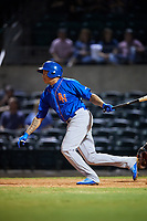 Midland RockHounds second baseman Yairo Munoz (10) follows through on a swing during a game against the Arkansas Travelers on May 25, 2017 at Dickey-Stephens Park in Little Rock, Arkansas.  Midland defeated Arkansas 8-1.  (Mike Janes/Four Seam Images)