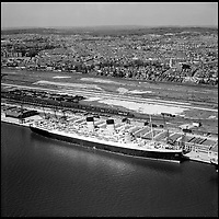 BNPS.co.uk (01202 558833)<br /> Pic: Aerofilms/HistoricEngland/BNPS<br /> <br /> Southampton - RMS Marentania, 18 April 1949.<br /> <br /> Stunning historic aerial photos of seaside towns, naval bases, ports and shipyards which tell the story of Britain's once-great maritime tradition feature in a new book.<br /> <br /> The fascinating archive of black and white images includes views from a bygone age such as Brighton's famous West Pier, Grimsby's burgeoning fishing fleet, and London's dock yards.<br /> <br /> Iconic ships were also captured from the skies including the Cutty Sark in its final seaworthy years on the Thames, HMY Britannia in 1959, the RMS Queen Mary in 1946 and the SS Queen Elizabeth in 1969 about to make her maiden voyage.<br /> <br /> England's Maritime Heritage from the Air, by Peter Waller, is published by English Heritage and costs &pound;35.