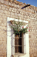 Window of an old house in the town of El Fuerte, Sinaloa, Mexico. The Spanish colonial town of El Fuerte is a popular stopover for tourists taking the Copper Canyon train or El Chepe.
