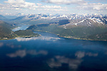 Broken cumulus cloud seen from above looking down over mountains, western Norway near Tromso