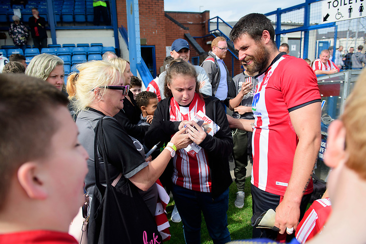 Lincoln City's Michael Bostwick signs autographs for fans<br /> <br /> Photographer Chris Vaughan/CameraSport<br /> <br /> Football Pre-Season Friendly (Community Festival of Lincolnshire) - Gainsborough Trinity v Lincoln City - Saturday 6th July 2019 - The Martin & Co Arena - Gainsborough<br /> <br /> World Copyright © 2018 CameraSport. All rights reserved. 43 Linden Ave. Countesthorpe. Leicester. England. LE8 5PG - Tel: +44 (0) 116 277 4147 - admin@camerasport.com - www.camerasport.com