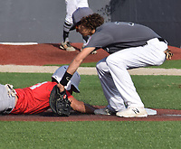 RICK PECK/SPECIAL TO MCDONALD COUNTY PRESS<br /> McDonald County's Brandon Armstrong dives back to first to avoid being picked off during McDonald County's 6-6 tie with Linn County on July 8 in the Patriot Classic 18U Baseball Tournament in Fort Scott, Kan.