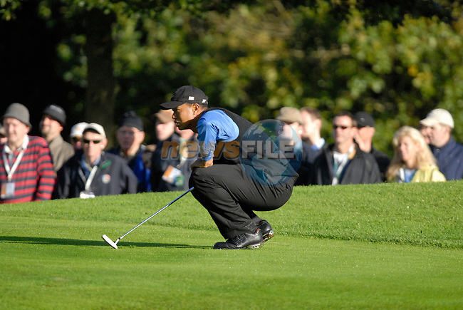 Ryder Cup 206 K Club, Straffan, Ireland..American Ryder Cup team player Tiger Woods lines up his putt on the 2nd green during the morning fourballs session of the second day of the 2006 Ryder Cup at the K Club in Straffan, Co Kildare, in the Republic of Ireland, 23 September 2006...Photo: Eoin Clarke/ Newsfile.