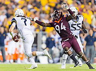 Landover, MD - SEPT 3, 2017: West Virginia Mountaineers quarterback Will Grier (7) avoids the tackle of Virginia Tech Hokies defensive end Trevon Hill (94) during game between West Virginia and Virginia Tech at FedEx Field in Landover, MD. (Photo by Phil Peters/Media Images International)