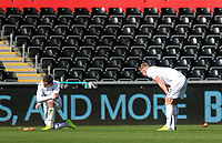 SWANSEA, WALES - MARCH 25:  Connor Roberts of Swansea City and Adam King of Swansea City look dejected as Referee A Coggins blows the final whistle of the Premier League International Cup Semi Final match between Swansea City and Porto at The Liberty Stadium on March 25, 2017 in Swansea, Wales. (Photo by Athena Pictures)Athena Pictures)